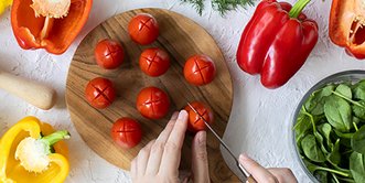 Score the tomatoes for easy peeling